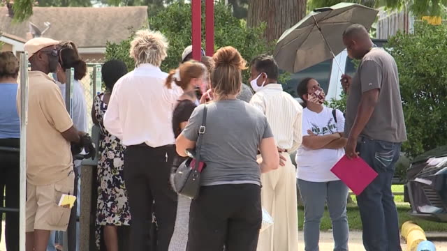 wgno new orleans la us people waiting to collect rental assistance on saturday august 1 2020 - unemployment stock videos & royalty-free footage