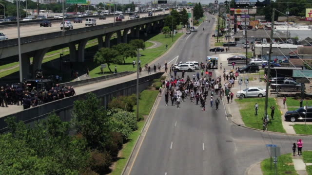 wgno new orleans la us protestors being turned back by police drone aerials black lives matter protestors walk on freeway in new orleans on monday... - armored vehicle stock videos & royalty-free footage