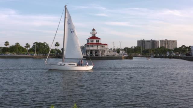 WGN New Orleans LA US Sailboats on Lake Pontchartrain at sunset on Thursday May 11 2017