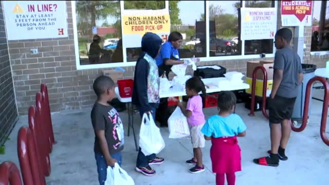 new orleans, u.s. - schools providing food to families in need while schools are closed on wednesday, march 18, 2020. - school dinner stock videos & royalty-free footage