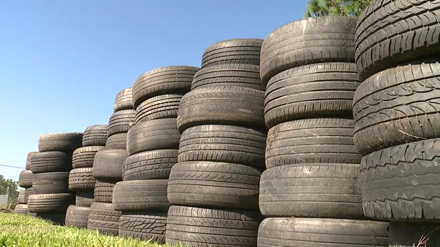 new orleans, u.s. - stacks of used tires, on thursday, november 19, 2020. - black colour stock videos & royalty-free footage