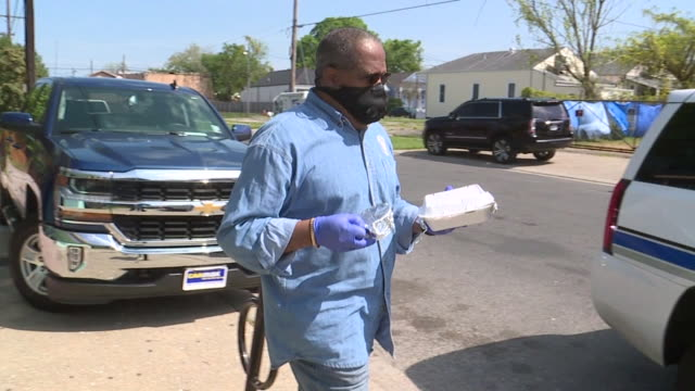 wgno new orleans la us state senator troy carter giving meals to first responders and other essential personnel during covid19 pandemic in algiers on... - medical glove stock videos & royalty-free footage