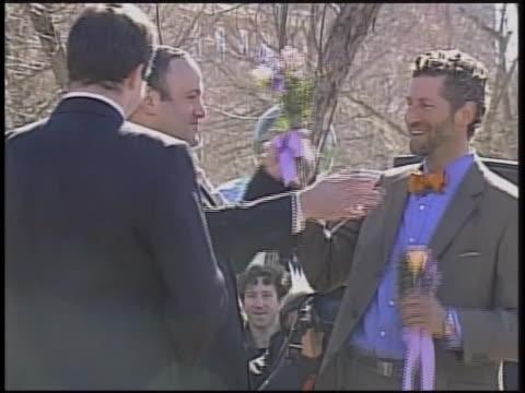 new paltz mayor jason west solemnizes the marriage of two gay men. - アルスター郡点の映像素材/bロール