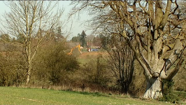 new planning rules set out by government berkshire newbury ext stream surrounded by trees close shot grass bird flying off grass countryside with... - newbury england stock videos & royalty-free footage