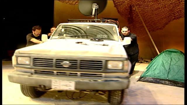 vidéos et rushes de new play opens about iraq war; england: hampshire: basingstoke: haymarket theatre: int high angle shot of empty theatre auditorium actors on stage... - haymarket