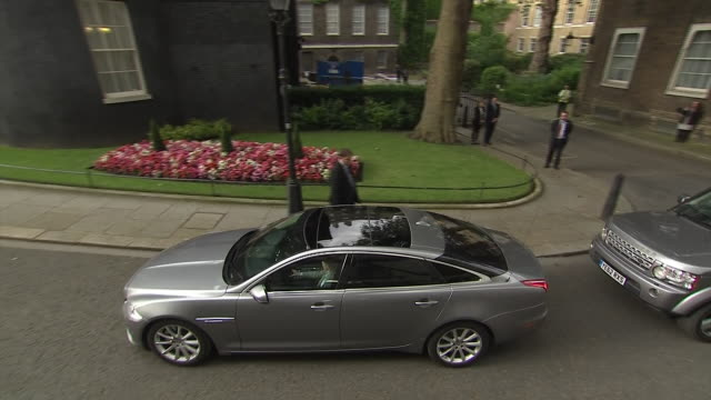 New Prime Minister Theresa May and her husband Philip arriving at 10 Downing Street and approaching the lecturn for her first speech as leader