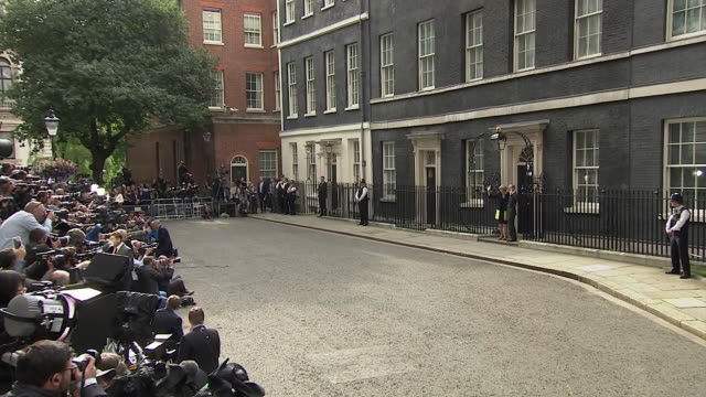 new prime minister theresa may and her husband philip entering 10 downing street for the first time since she became leader - downing street stock videos and b-roll footage