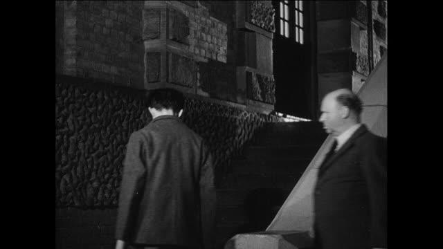 tu new prisoners walk up stairs at prison / uk / guard walks new prisoner up stairs / guard unlocks entry door - prisoner education stock videos & royalty-free footage