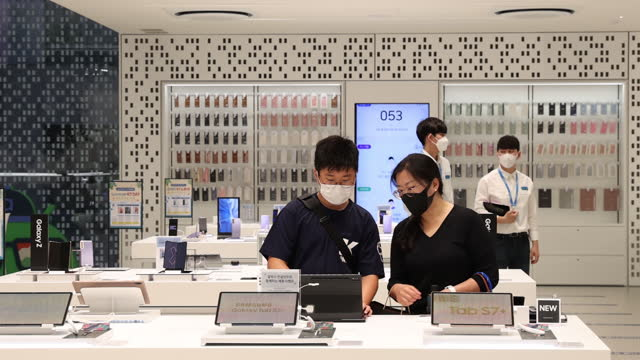 new products on display at samsung's digital plaza in seoul, south korea, on saturday, july 3, 2021. - wrist watch stock videos & royalty-free footage
