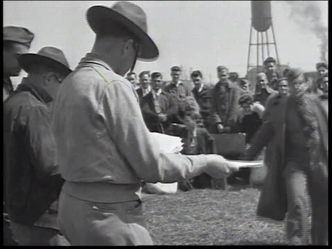 1934 ws new recruits and discharged workers collect papers / united states - 1934年点の映像素材/bロール