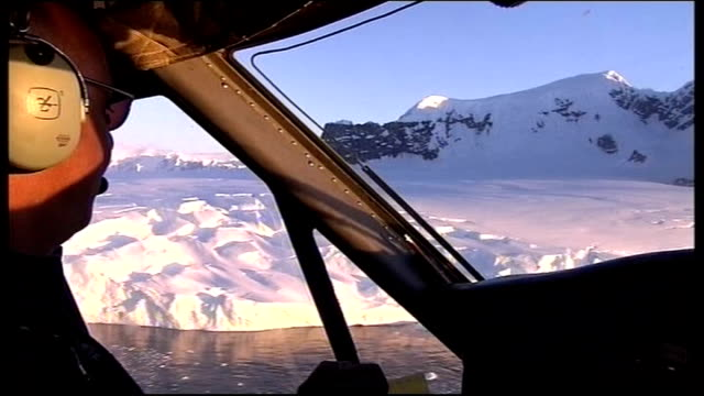 stockvideo's en b-roll-footage met new report warns that glaciers shrinking fast antarctica swathes of broken ice floating next ice shelf int helicopter helicopter pilot speaking sot... - vermindering