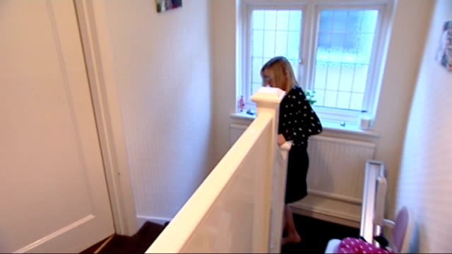 new reports shows uk cancer survival rates amongst the worst in europe england int ruth mcdonagh up stairs on stair lift and into bedroom ruth... - stair lift stock videos and b-roll footage
