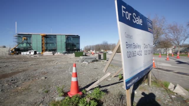 a new retail complex stands in christchurch new zealand on thursday aug 29 general views an office building under construction a sign reads 'road... - カンタベリー点の映像素材/bロール