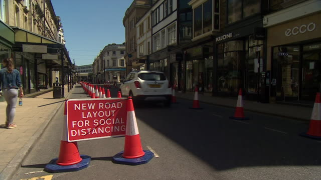 new road layout in harrogate town centre to allow for pedestrians to socially distance on pavement during coronavirus pandemic - pedestrian stock videos & royalty-free footage