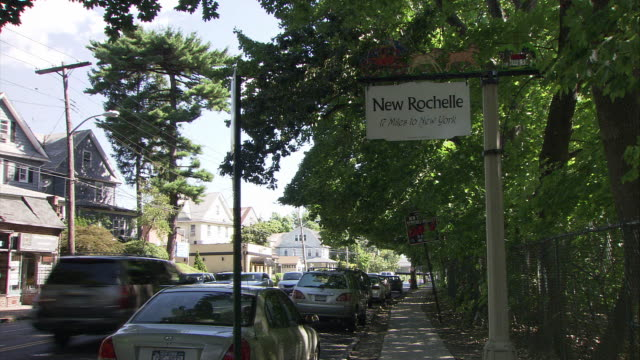 ws new rochelle welcome sign in suburban area / new rochelle, new york, usa - welcome sign stock videos & royalty-free footage