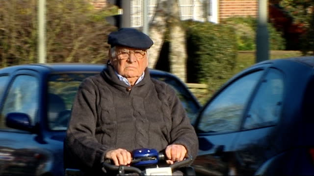 new scooter allows elderly jewish man mobility on the sabbath; england: london: ext albert rosenberg, elderly jewish man, along path to new israeli... - itv london tonight weekend stock-videos und b-roll-filmmaterial