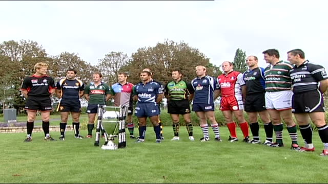 vidéos et rushes de new season preview sound overlay unidentified rock music ext rugby union team members posing with guinness premiership cup in the foreground ends - rock moderne