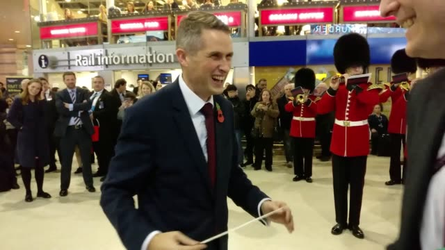 New Secretary of State for Defence Gavin Williamson visits London Waterloo train station where he conducts a military band and chats with members of...