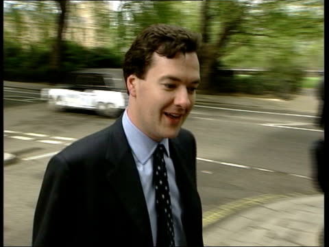 london ext george osborne mp towards along road pan as past press into building george osborne mp interviewed sot person most terrified of gordon... - david cameron politician stock videos & royalty-free footage