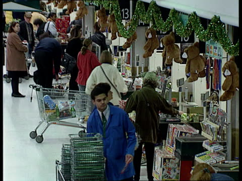 "; a)nat: england: lacms sign in supermarket ""festive food at the same low prices"" pull out tlms people at check outs with christmas decorations in... - plastic bag stock videos & royalty-free footage"