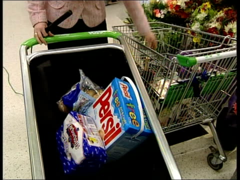 new shopping trolley design itv lunchtime news emma murphy hartlepool i/c as pushing new shopping trolley along then placing items in trolley philip... - itv lunchtime news stock videos & royalty-free footage
