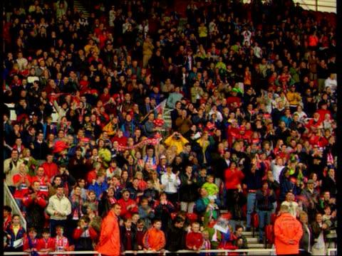 new signing paul gascoigne appears before middlesbrough fans itn cleveland middlesbrough riverside stadium ext paul gascoigne wearing middlesbrough... - fußballplatz stock-videos und b-roll-filmmaterial