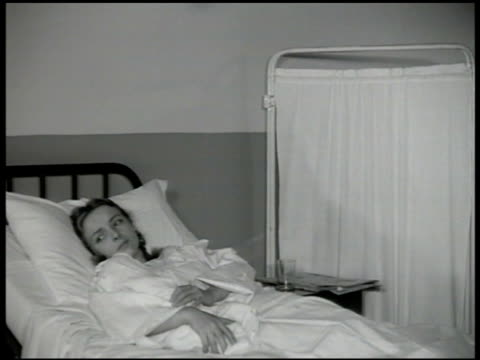 dramatization new single mother in hospital ward shared room holding wrapped baby in bed sot doesn't know how she can earn enough to take care of... - court room stock-videos und b-roll-filmmaterial