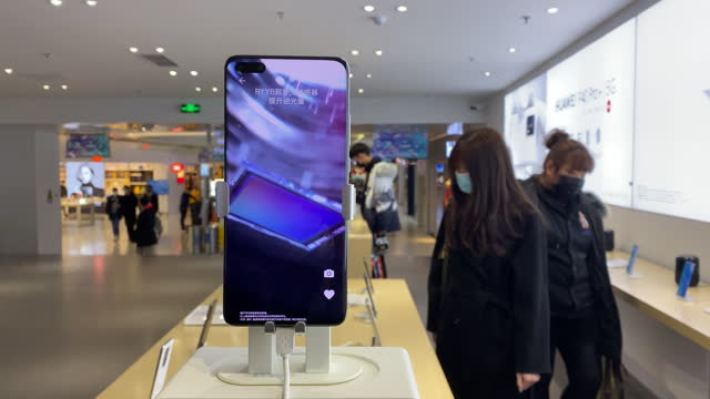 new smart phone is shown on the counter in a huawei store. although huawei is suppressed in the international market, it still sells well in china's... - technology stock videos & royalty-free footage