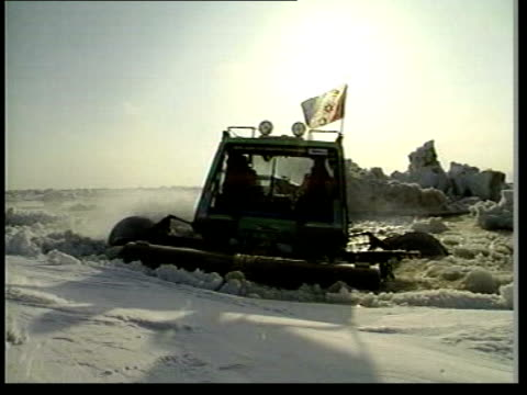 New snow vehicle tested on Thames LIB Alaska Bering Strait Snowbird 5 rolling down ice into water Snowbird 5 cutting thru water Snowbird breaking...