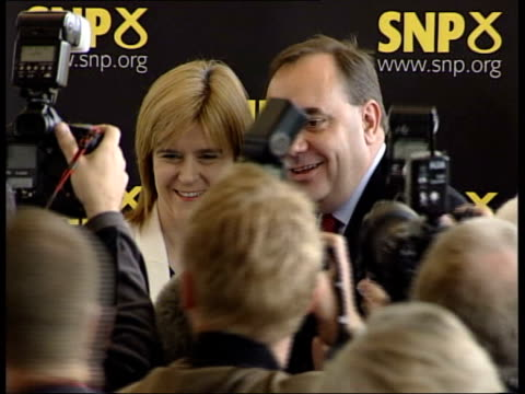 new snp leader alex salmond mp kissing woman in press conference zoom in salmond posing with woman as press crowd round in f/g - alex salmond stock videos & royalty-free footage