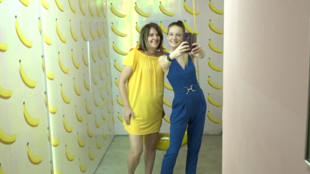 a new so called selfie museum in budapest that lets visitors pose by pink palm trees and frolic in multicoloured sprinkle baths is proving to be a... - museum stock videos & royalty-free footage