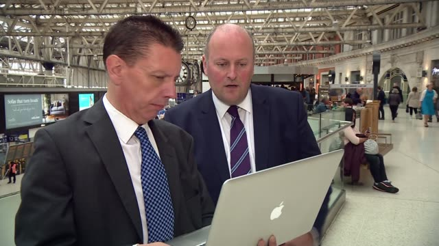 New South West Trains Managing Director promises improvements to service INT Reporter and Andy Mellors looking at laptop