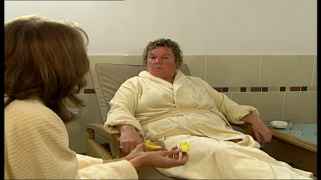 new spa opening in bethnal green vox pops woman in spa sot - bethnal green stock videos & royalty-free footage