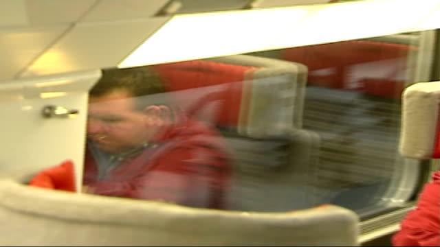 new st pancras eurostar service begins int passengers seated on eurostar train reporter to camera passengers seated on eurostar train reporter to... - eurostar stock-videos und b-roll-filmmaterial