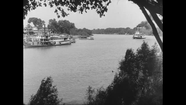 1928 a new steamboat approaches a dock to much fanfare - 1928 stock videos & royalty-free footage