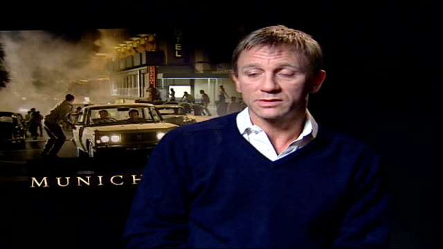 new steven spielberg film 'munich' premieres in london daniel craig interviewed sot thing you take from movie is interest in trying to find out a bit... - daniel craig actor stock videos and b-roll footage