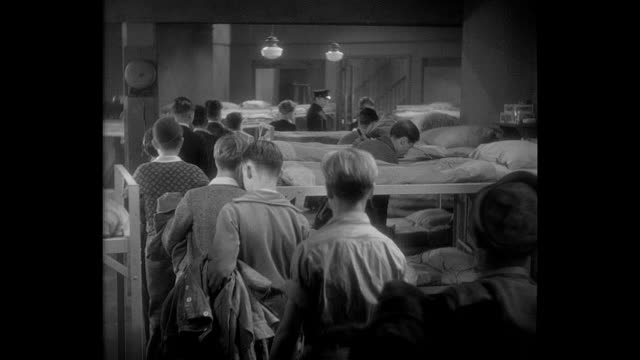 1932 new students are shown their beds at the state industrial school (prison) for boys - dorm room stock videos and b-roll footage