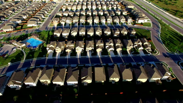 new suburb outside of austin texas near round rock aerial house after house after house - townhouse stock videos & royalty-free footage