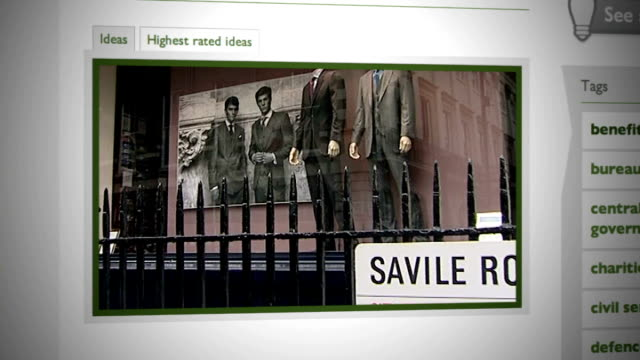 new suits displayed on mannequins in shop window on savile row / tailor measuring and cutting cloth - savile row stock videos and b-roll footage