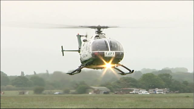 new surrey air ambulance service may be cancelled after complaints over noise levels; england: surrey: int air ambulance pilot at controls of air... - hovering stock videos & royalty-free footage
