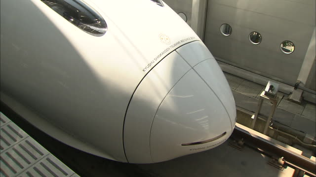 a new swallow 800 series high speed train the tsubame waits at kagoshimachuo station in japan - kyushu shinkansen stock videos and b-roll footage