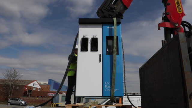 new swarco ag electric vehicle rapid charger unit held by a crane in canterbury, u.k. on thursday, april 8, 2021. - automobile industry stock videos & royalty-free footage