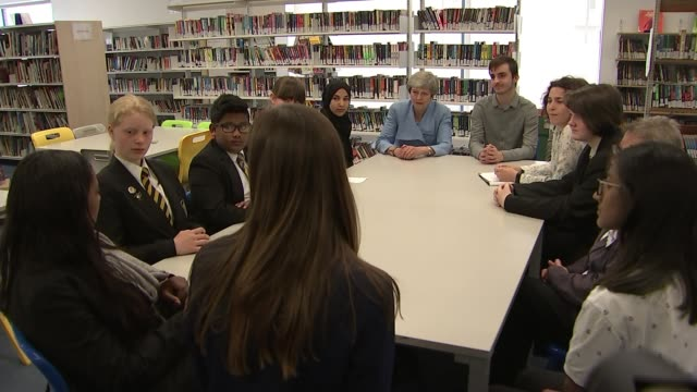 New teachers to be trained to spot early signs of mental health problems in children ENGLAND London Southfields Academy INT Theresa May MP chatting...
