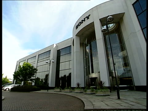 dvd players location unknown ext gvs exterior of sony hq building mark knox interview sot reply was that they would talk about some things but not... - dvd stock videos & royalty-free footage