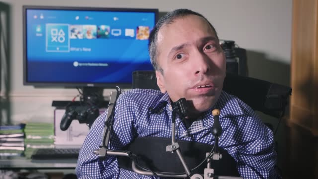 new technology opens up gaming world to severely disabled gamers england int ajay yadaz who suffers from spinal muscular atrophy interview sot - atrophy stock videos & royalty-free footage