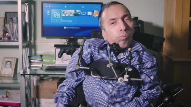 new technology opens up gaming world to severely disabled gamers england int ajay yadaz who suffers from spinal muscular atrophy interview sot... - disability technology stock videos & royalty-free footage
