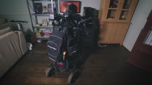 new technology opens up gaming world to severely disabled gamers england int various of ajay yadaz who suffers from spinal muscular atrophy paying... - disability technology stock videos & royalty-free footage