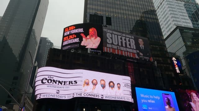 new times square billboard by the lincoln project depicts ivanka trump presenting the number of new yorkers and americans who have died due to... - vanity fair stock videos & royalty-free footage