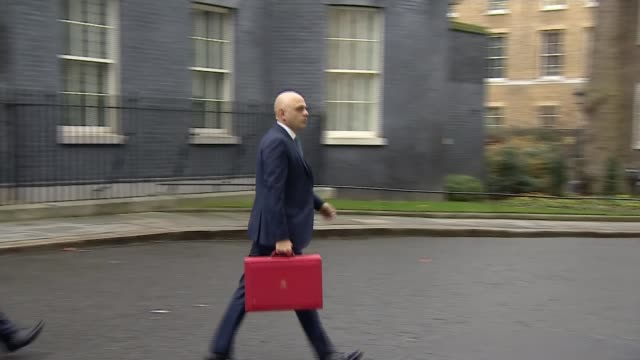 new tory mps arrive in westminster following general election victory; england: london: downing street: ext sajid javid mp along past christmas tree... - red stock videos & royalty-free footage