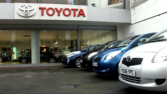 stockvideo's en b-roll-footage met new toyota cars in forecourt of car showroom - toyota motor
